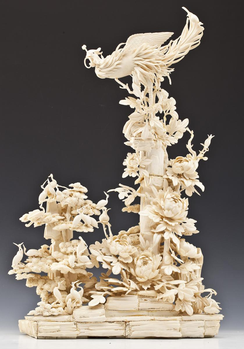 24 inch Carved Ivory Figure of Phoenix in Foliage ($2,000-3,000)