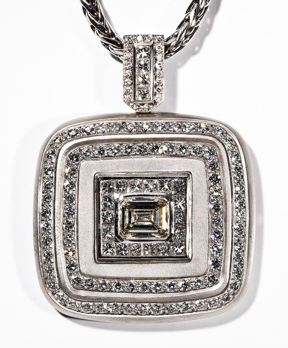 8.24 ctw Diamond Pendant ($7,500)