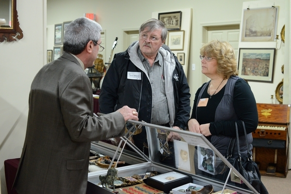 Ed Rowe, left, of Cordier Auctions and Appraisals visits with Dennis and Kim Williams of Columbia County. Auctioneer Kim Williams, of Kim's Auction Service, is president-elect of the Pa. Auction Association.  Photo Amy Spangler